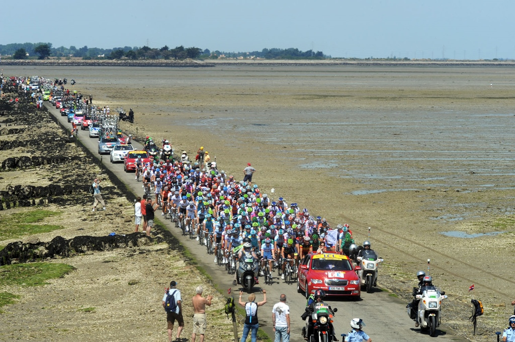 THE PELOTON CROSSES THE PASSAGE DU GOIS ON STAGE ONE OF THE 2011 TOUR DE FRANCE